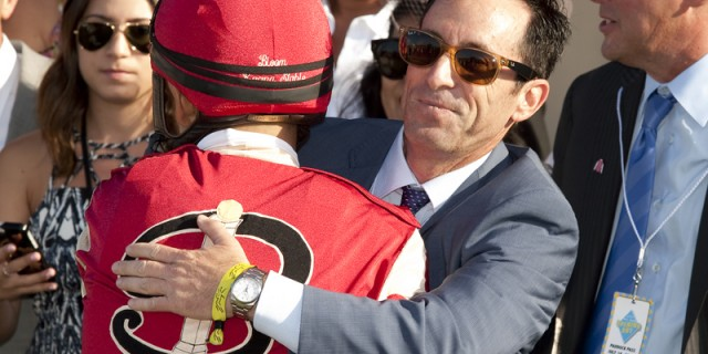 Owner Jeff Bloom of Bloom Racing Stables' has a hug for jockey Mike Smith after Soul Driver's victory in the $100,000 Oceanside Stakes, Thursday, July 16, 2015 at Del Mar Thoroughbred Club, Del Mar CA.© BENOIT PHOTO